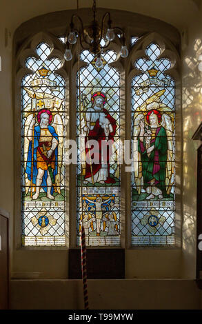 Stained glass window Saint Michael, Jesus Christ, Saint Gabriel at Waldringfield church, Suffolk, England, UK c 1917 by Powell - Stock Image