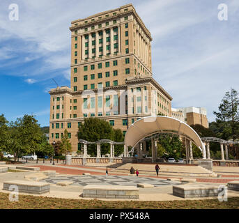 ASHEVILLE, NC, USA-10/17/18: The 17-story Buncombe County Courthouse sets behid an amphiteater in Pack Square. - Stock Image