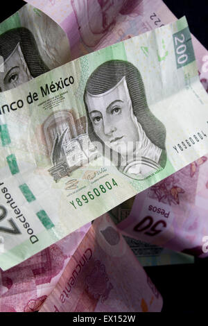 Close up shot of mexican currency over black background - Stock Image