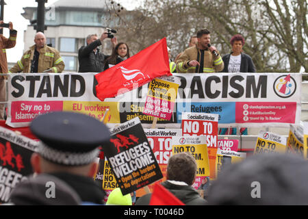 London, UK - 16 March 2019: Riccardo la Torre Fire Brigade Regional Secretary addresses the gathered demonstrators at Park Lane ahead of the march to Downing Street. Thousands of people took part in the UN Anti-Racism Day demonstration that took place in central London on 16 March. The demonstration which began in Park Lank and ended outside Downing Street was organised by Stand Up to Racism and Love Music Hate Racism and supported by the TUC and UNISON. Photo: David Mbiyu Credit: david mbiyu/Alamy Live News - Stock Image