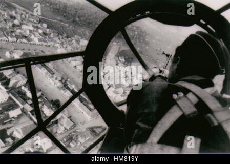 WW2 Luftwaffe Heinkell III Bomber over England bomber aimer in front of the aircraft - Stock Image