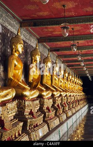 Thailand, Bangkok. Buddha statues at Wat Suthat. - Stock Image