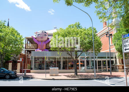 Inflatable sculpture perched atop a section of the art museum in Albury, Australia. - Stock Image