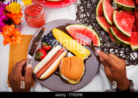 Overhead view of food in plate at table - Stock Image
