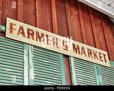 Farmer's Market advertising or marketing sign or signage on side of roadside country market in Pike Road Alabama, USA. - Stock Image