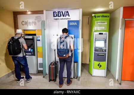 Cartagena Colombia Aeropuerto Internacional Rafael Nunez Airport inside concourse terminal self-service ATM automatic teller machine BBVA Servibanca H - Stock Image