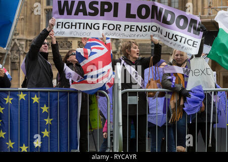 Women from the Essex branch of the WASPI (Women's Action Against State Pension Injustice) protest on College Greeen in Westminster, the morning after another of Prime Minister Theresa May's Brexit deal votes failed again in Parliament, on 13th March 2019, in London, England. - Stock Image