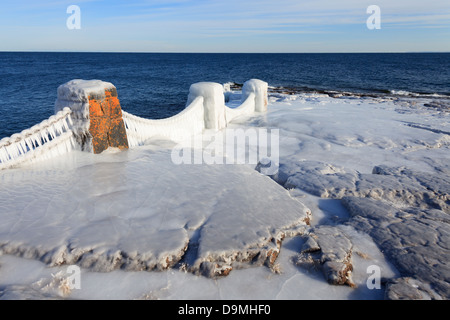 Winter view of ice covered Lake Superior shoreline at Split Rock State Park, Minnesota. - Stock Image