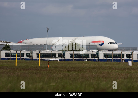 The crashed British Airways Boeing 777 jet stored near the place of incident when landed short of the runway at - Stock Image