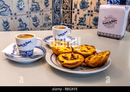 Pastel de belem or pasteis de nata custard tarts served with a cup of coffee at the historical Pasteis de Belem cafe in Belem, Lisbon, Portugal - Stock Image