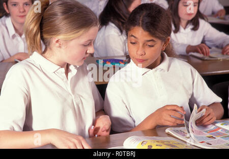 two high school girls in classroom - Stock Image