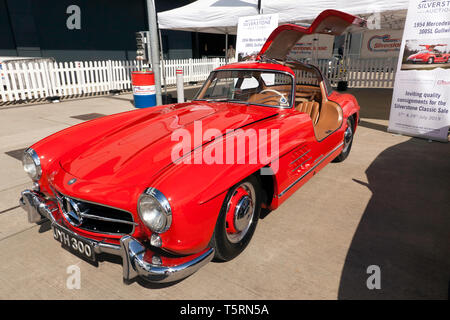 Three-quarter front view of a beautiful red 1954 Mercedes-Benz  300SL Gullwing  which will be for sale in the 2029 Silverstone Classic Car Auction - Stock Image