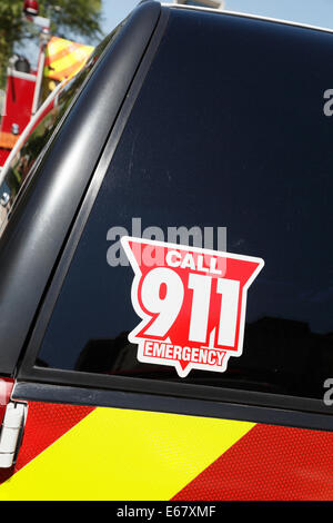 Emergency vehicle, close-up of call 911 decal. - Stock Image
