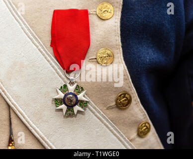 MOSCOW, AUGUST 16, 2018. Napoleon era Order of the Legion of Honor hangs on a red ribbon on a French army uniform during International Times and Epoch - Stock Image