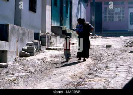 An indigenous Tz'utujil Maya woman walking along the street in San Lucas Tolimán, Guatemala. - Stock Image