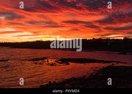 Crail, East Neuk of Fife, Scotland, UK. 24th Oct, 2018. uk weather - skies on fire at sunset over the sea and village of Crail on the Fife coast Credit: Kay Roxby/Alamy Live News - Stock Image