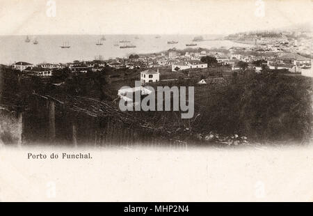 General view of the port of Funchal, Madeira, with ships in the bay.      Date: circa 1905 - Stock Image