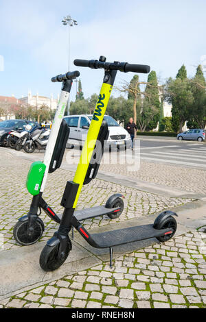Dockless electric scooters e-scooters (Lime-S and Hive) for hire in Lisbon, Portugal - Stock Image
