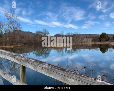 A view from the greenway at Cove Lake State Park, Caryville, Tennessee in winter with blue sky and clouds. - Stock Image