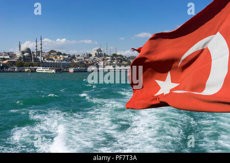 View of Istanbul from the ferry with a flag in the wind - Stock Image