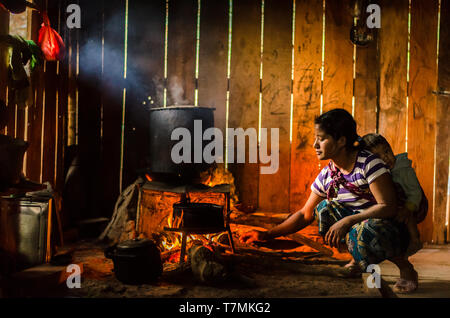 A young mother preparing the family dinner., Phongsali, Laos - Stock Image