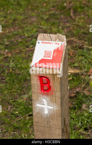 Orienteering control point with QR (Quick response) code label at Moses Gate Country Park, Bolton. - Stock Image