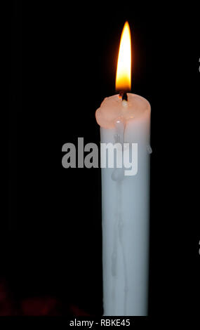Lit candle during power outage. - Stock Image