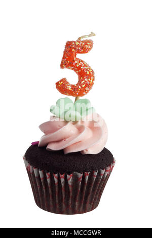 Mini cupcake with birthday candle for five year old isolated on white background - Stock Image