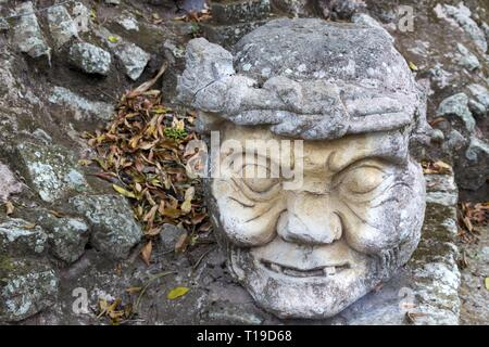 Old Man Head Carved from Stone in World Famous Copan Ruins Archeological Site of ancient Maya Civilization, a UNESCO World Heritage Site in Honduras - Stock Image
