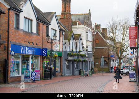 Solitary woman walks past The Generals Arms pub, High Street, Chesham, Bucks, England, UK - Stock Image