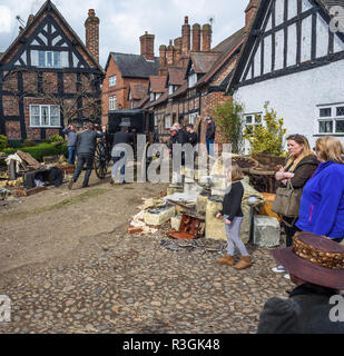 Film production crew push an Edwardian carriage through the street of Great BUdworth, Cheshire, Uk on the production of the BBC War Of The Worlds 2018 - Stock Image