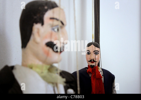 Close of of a large male Sicilian marionette / puppet with mustache out of focus. Focus on puppet in the background - Stock Image