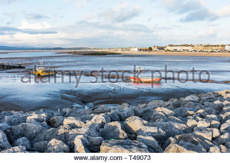Boats moored at low tide on the sand in Morecambe Bay, Lancashire, England, UK - Stock Image