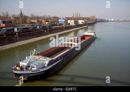 Barge reversing out of port - Stock Image