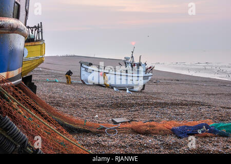 Hastings fishing boat being hauled ashore after night fishing in the English Channel. Hastings has the largest beach-launched fishing fleet in Europe. - Stock Image