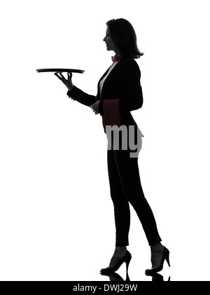 one  woman waiter butler holding empty tray in silhouette on white background - Stock Image