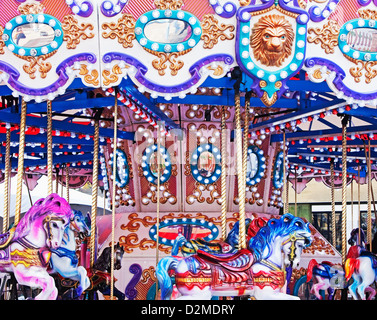 merry-go-round in city center at Christmas time - Stock Image