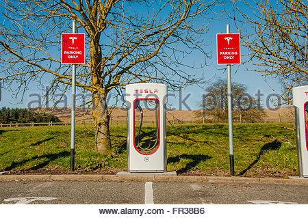 A Tesla electric car charging units on the forecourt at Abington Services, just off the M74 in Scotland - Stock Image