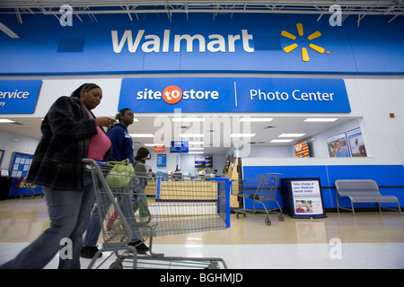Shoppers inside a Walmart Supercenter in Arkansas, U.S.A. - Stock Image
