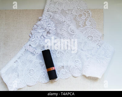 Shopping on site, and the concept of fashion. Lace glamorous white sexy panties and lipstick, accessories for women, top view, flat lay. - Stock Image