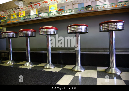 Chrome stools at an old-fashioned ice cream parlor - Stock Image