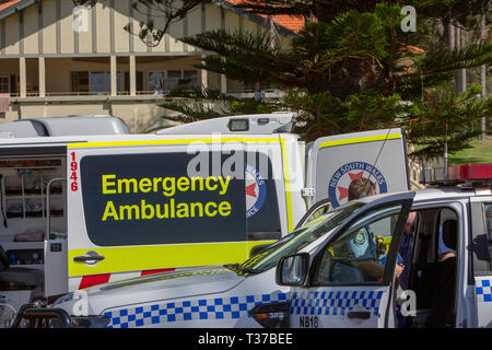 New South Wales police and ambulance attend a scene at Palm beach Sydney where surf rescue volunteers plucked a rock fisherman from near drowning - Stock Image