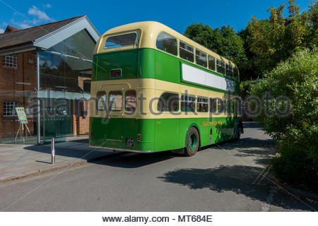 A restored SouthDown bys in green and cream livery outside the Farnham Maltings, Surrey, UK - Stock Image
