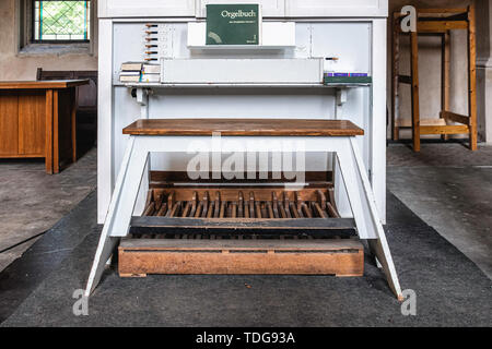 Zionskirche, Zion church interior, old organ with book of organ music, Germany - Stock Image