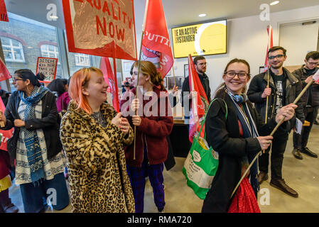 London, UK. 14th February 2019. The IWGB union and students occupy the foyer of the Ben Pimlott buidling at the launch their campaign for Goldmsiths, University of London, to directly employ its security officers. Currently they are employed by CIS Security Ltd on low pay and minimal conditions of service, and CIS routinely flouts its legal responsibilities on statutory sick pay and holidays. Credit: Peter Marshall/Alamy Live News - Stock Image