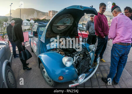 La Condamine, Monaco. 16th Feb, 2019. People attend a vintage race car show organised by a German auto club in La Condamine, Monaco, Feb. 16, 2019. Car owners in the auto club showed dozens of different vintage race cars in Monaco to express their passion about motor vehicles. Credit: Zheng Huansong/Xinhua/Alamy Live News - Stock Image