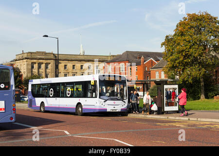 Passengers disembark from the 501 service at stop BB on Black Horse Street, Bolton, adjacent to Moor Lane bus station. - Stock Image