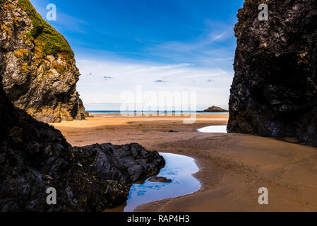 View from a rocky cove on Crantock Beach, Newquay, Cornwall, UK - Stock Image