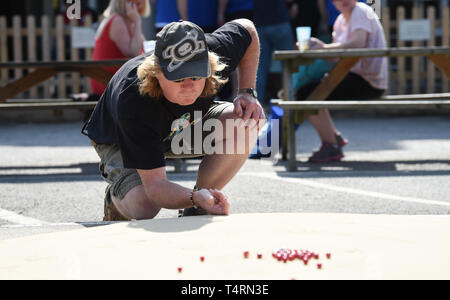 Crawley Sussex, UK. 19th Apr, 2019. Action from the World Marbles Championship held at The Greyhound pub at Tinsley Green near Crawley in Sussex . The annual event has been held on Good Friday every year since the 1930s and is open to players from around the world Credit: Simon Dack/Alamy Live News - Stock Image