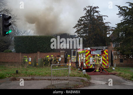 Whetstone, United Kingdom. 03 January 2019. Eight fire engines and around 60 firefighters were called to a fire at a house on Totteridge Village, Whetstone. The roof of a detached house was alight. There are no reports of any injuries. The Brigade was called at 14:07 and the fire was under control by 18:05. Fire crews from Barnet, Finchley, Southgate and other surrounding fire stations attended the scene. Credit: Peter Manning/Alamy Live News - Stock Image